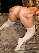 Horny housewife playing on her bed