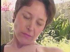 Mature woman masturbates her big hairy cunt