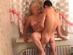 Russian old slut sucked off young boy's pecker