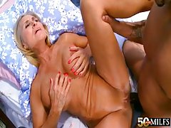 Busty mature tries anal interracial