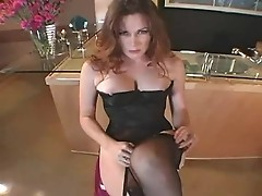 Redhead is taking of pantyhose and gets luscious
