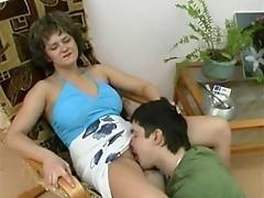 Mature lady seduces young boy