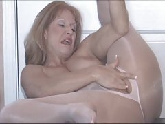 Mature Slutty Sammi has fun in her pale pink pantyhose (TheNylonChannel)