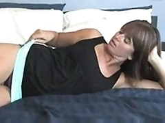 Sexy milf plays with herself in a laid out bed