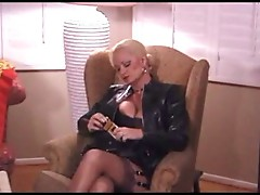 Hot Mature Blonde Smoking In Leather