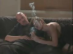 Lisa sucks a hard cock while smoking