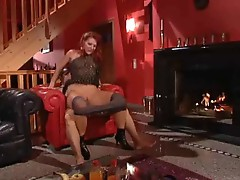 Mature slut in black stockings with fiery red hairs