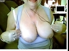 One of the horniest amateur grannies strips and poses on nude webcams