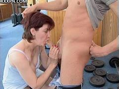 Sappy boy engulfing cock and drilling butt hole of a milf couple in the gym
