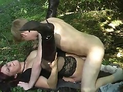 Mature Babe With A Young Boy In The Forest