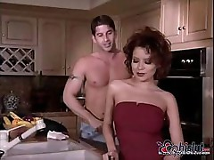 Gina Ryder sucks on a young stud's cock and then fucks him