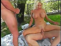 Busty Kelly takes on two cocks and sucks and fucks them both