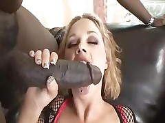 Busty Katie Kox puts that large black cock in her mouth and fucks