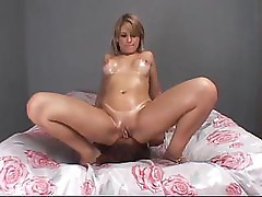Two lesbian babes are getting busy on the bed and face fucking