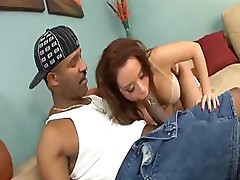 Nicole sucks on his black cock and then gets fucked by it