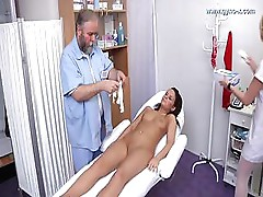 Doctor Checks Brunette s Holes