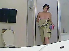 Hidden camera shows this girl taking a shower without knowing