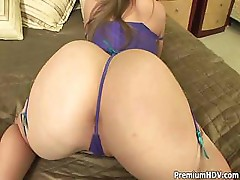 Sunny shows off in the mirror and uses a dildo to fuck herself