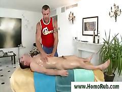 Muscular masseur gives cock massage