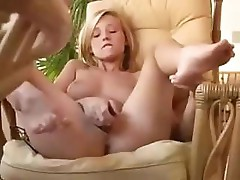Amateur blonde babe is masturbating on her chair and cums