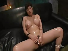 Asian babe gets oiled up and masturbates before hard fucking