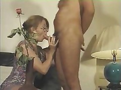 French MILF sucks his cock and gets fucked on a leather couch