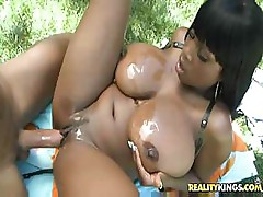 Big black gal with huge tits bends over to get fucked by white dick