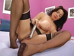 Seianna West strips and masturbates with dildo on the bed