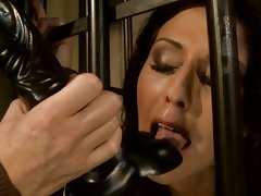 Mandy Bright sucking a black dildo of terror guard
