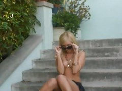 Aaliyah Love in outdoor wearing shades like seducing