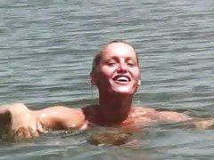 Kathia Nobili swimming naked at the water