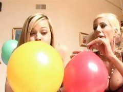 Alexis Texas and Puma Swede blowing a balloons