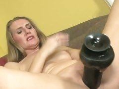 Sarah James sitting on a couch dildo fucking too hard