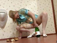 Drunk blonde horny riding bottle in bathroom