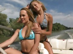 Anita Pearl and Blue Angel driving a speed boat