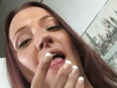 Taylor Bliss licking her fingers with cum