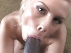 Tara Lynn taking her partner's cock into mouth