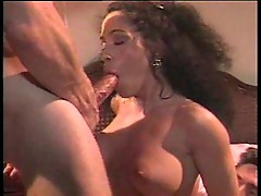 Curly black haired babe in threesome