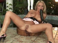 Blonde naughty babe working on the oustanding