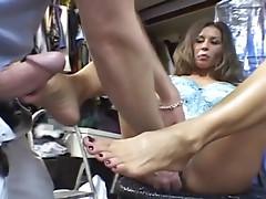 Busty dolls has her feet creamed