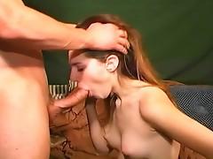 Sexy redhead sucking onto the big cock