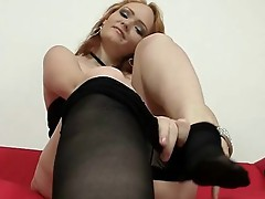 Redhead babe pulling pantyhose tights out her pussy