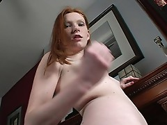 Redhead gets naked