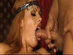 Asia D&#039;Argento sucks two hard cocks for facial