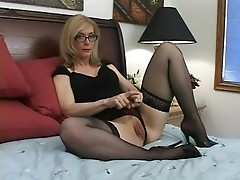 Mature blonde slut in specs enjoys mouth jobs