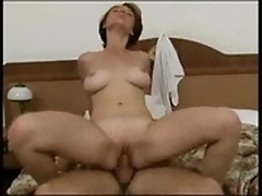Big-breasted babe goes riding on the phallus