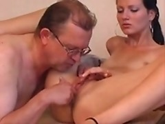 A dodderer and sexy brunette skipt are making sex after playing cards