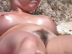 Voyeur spies on trimmed pussy at nudist beach
