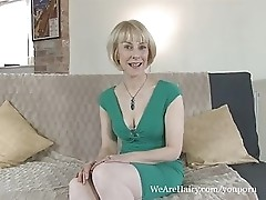 Hot mature Hazel flicks her moist hairy pussy
