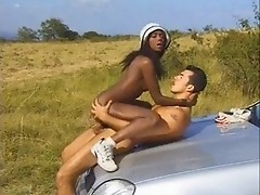 Bronze-skinned Bagheera is banging a white guy by the car